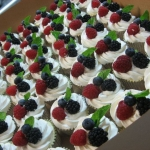 delicious cupcakes with berry toppings