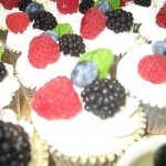delicious cupcakes with berry toppings 2
