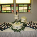 wedding cake with cupcake display