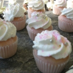 pink champagne cupcake filled with cream cheese mousse